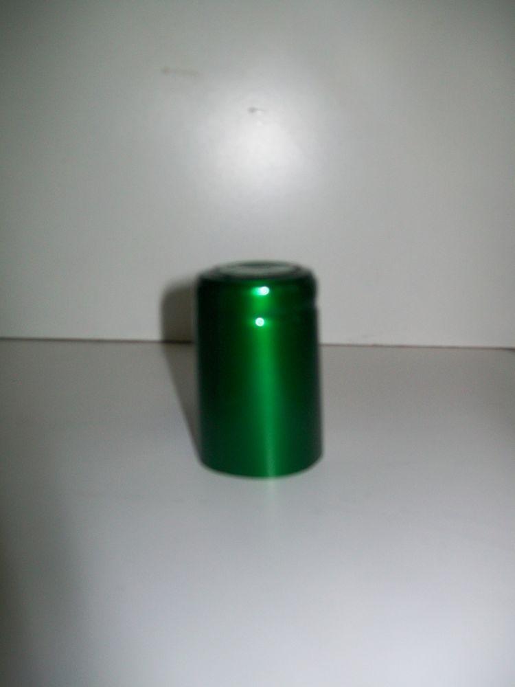 Capsula termoretraibile verde.